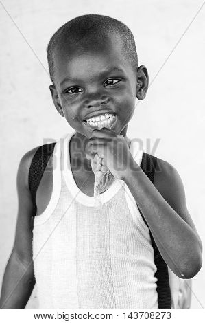 KARA, TOGO - MAR 9, 2013: Unidentified Togolese boy portrait. Children in Togo suffer of poverty due to the unstable econimic situation