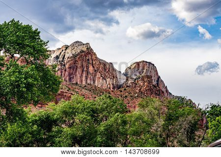 Clouds and Mountain Peaks with Beautiful Rock Formations in Zion National Park Utah.