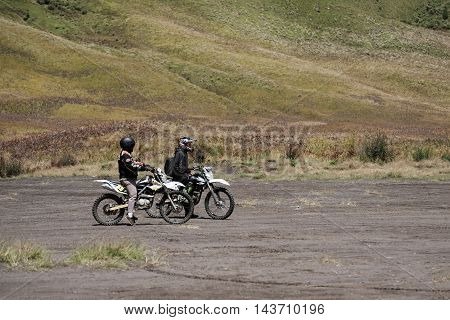 INDONESIA - AUG 12 - Unidentified motocross bikers parked in valley on the way to adventure trail at Mount Bromo, Indonesia on August 12, 2016