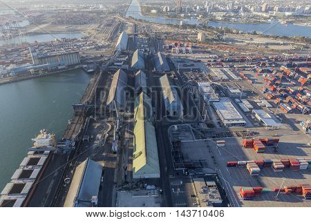 Long Beach, California, USA - August 16, 2016:  Aerial view of industrial waterfront pier in Long Beach, California.