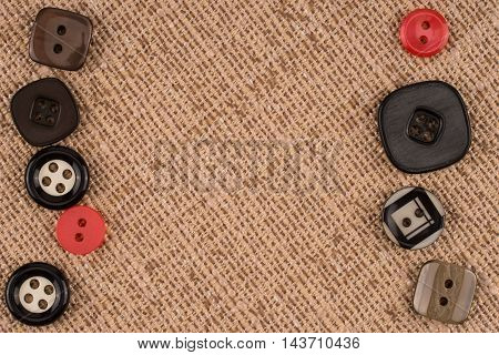 Fabric texture with buttons. Abstract background, empty template.