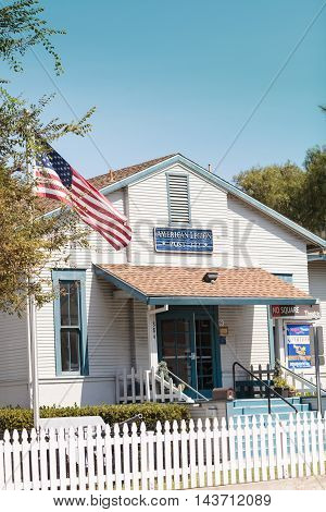 Laguna Beach, CA, USA - August 20, 2016: The front of the Laguna Beach American Legion building, Post 222, on a sunny summer day with a blue sky above. Editorial Use only.