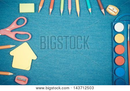School Supplies And Shape Of Building On Jeans Background, Back To School Concept, Copy Space For Te