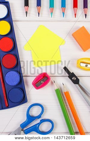 School Accessories And Shape Of Building On White Boards, Back To School Concept