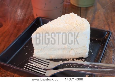 Closeup cheese cake on black plate, stock photo