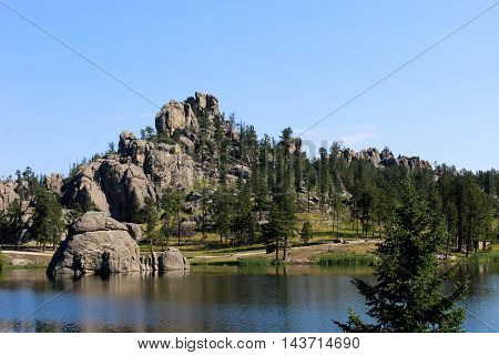 Rock formations near a quiet lake in the woods