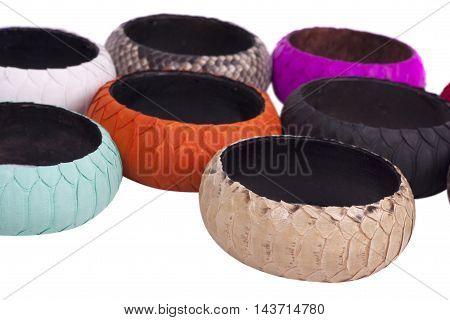 Fashion snakeskin (python) bracelets isolated on a white background