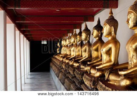 perspective of gold buddha statue in temple
