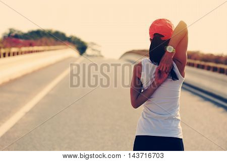 young fitness woman runner warm up on road