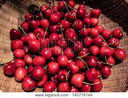 big red ripe strawberries in a basket outdoor macro closeup