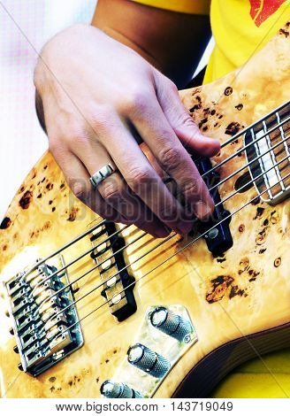 Hand Of Guitarist Playing The Electric Bass Guitar