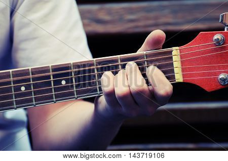 Hands playing acoustic guitar close up ,