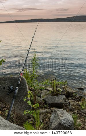 Long Rod Lying On The Rocks By The Lake
