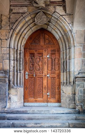 Old carved door of Gothic Cathedral of Saints Vitus, Wenceslaus and Adalbert, Prague, Czech Republic, Europe