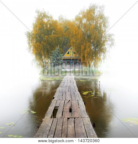 Old wooden house on the lake, foggy autumn morning, quiet mood