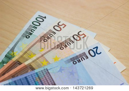 Euros on wood background - 100, 50, 20 euro