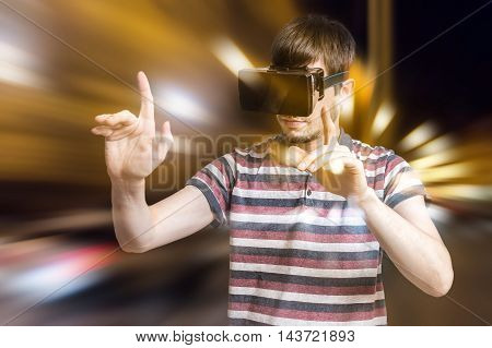Young Man Is Wearing 3D Virtual Reality Headset And Is Playing V