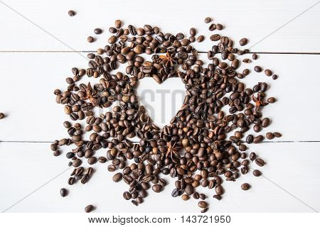 Coffe beans and anis on the table.