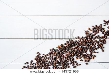Coffee beans and anis on the table.