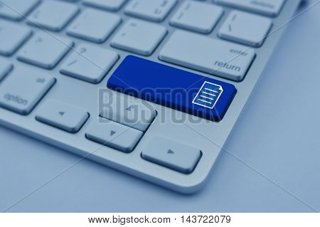 Document icon on modern computer keyboard button Network concept blue tone