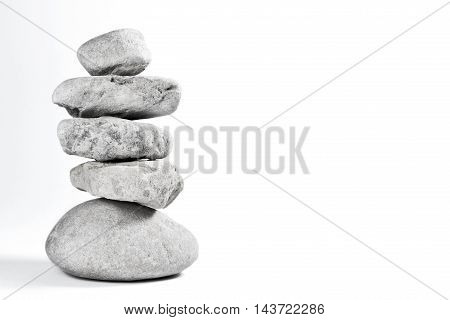 Stone stack or stack rock of pebbles with white background and copy space. Balanced stones.