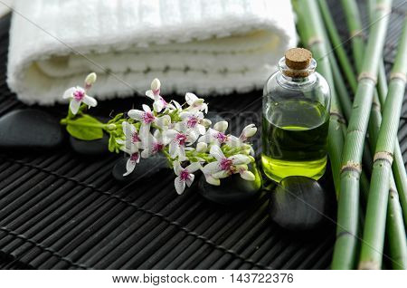 towel and stones and flower ,grove on bamboo mat