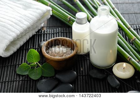 towel and stones and leaf on bamboo mat