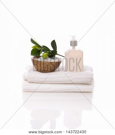 stones in bowl and gardenia,oil on towel â??white background