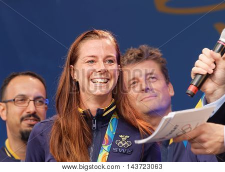 STOCKHOLM SWEDEN - AUG 21 2016: Swedish soccer player Lotta Schelin winning olympic silver smiling when the swedish olympic athletes are celebrated in Kungstradgarden Stockholm, Sweden, August 212016