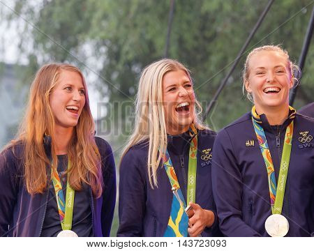 STOCKHOLM SWEDEN - AUG 21 2016: Happy swedish female soccer team when the swedish olympic athletes are celebrated in Kungstradgarden Stockholm Sweden August 212016