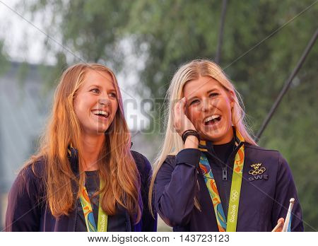 STOCKHOLM SWEDEN - AUG 21 2016: Happy swedish female soccer team when the swedish olympic athletes are celebrated in Kungstradgarden Stockholm, Sweden, August 21,2016