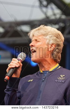 STOCKHOLM SWEDEN - AUG 21 2016: Swedish female soccer team captain Pia Sundhage singing when the swedish olympic athletes are celebrated in Kungstradgarden Stockholm Sweden August 21 2016