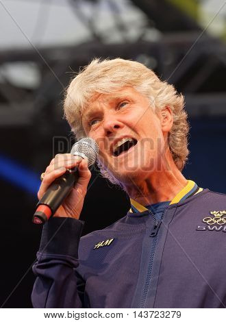 STOCKHOLM SWEDEN - AUG 21 2016: Swedish female soccer team captain Pia Sundhage singing when the swedish olympic athletes are celebrated in Kungstradgarden StockholmSwedenAugust 212016