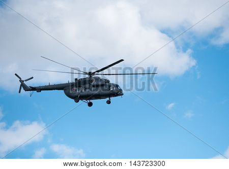 Military helicopter in the sky at day time