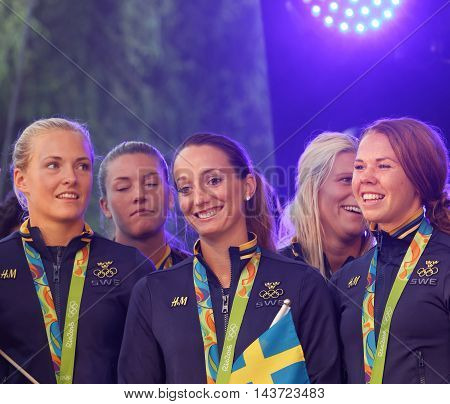 STOCKHOLM SWEDEN - AUG 21 2016: Swedish female soccer team showing their silver medals from the olympic games when the swedish olympic athletes are celebrated in Kungstradgarden StockholmSwedenAugust 212016