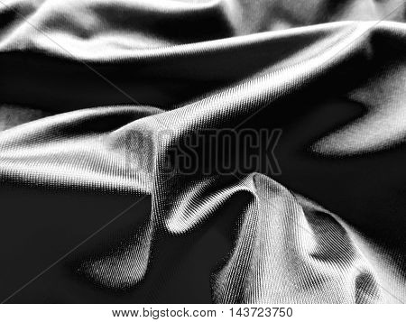 Wavy, black satin cloth or textile, textile background with copy space.