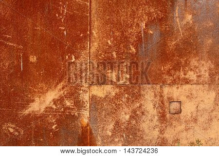 red and brown rust on metal plate
