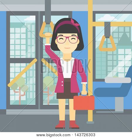 An asian woman traveling by public transport. Young woman standing inside public transport. Woman traveling by passenger bus or subway. Vector flat design illustration. Square layout.
