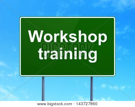 Studying concept: Workshop Training on green road highway sign, clear blue sky background, 3D rendering