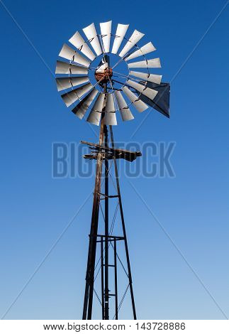Old and rickety farm multi bladed wind pump