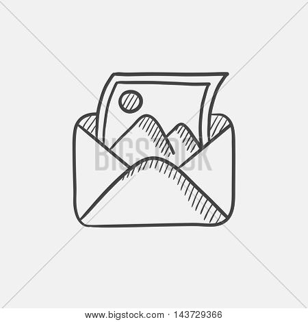 Envelope mail with photo sketch icon for web, mobile and infographics. Hand drawn vector isolated icon.