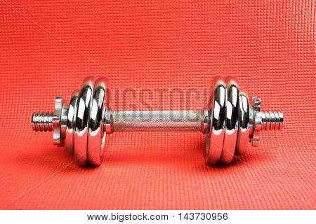 dumbbell sport equipment on the mat for fitness