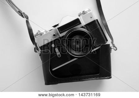 Vintage photo camera on white table