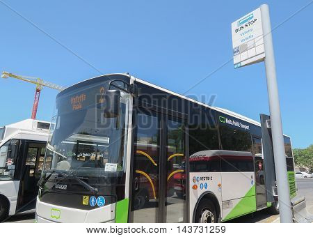 VALLETTA, MALTA - AUGUST 02 2016:Malta Public Transport Bus at Valletta bus stop  85% of passengers use a pre-paid card when travelling by bus in Malta.