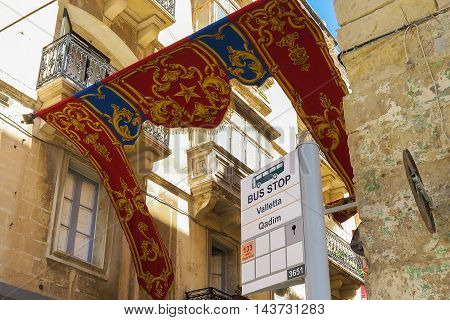 VALLETTA, MALTA - AUGUST 02 2016: Malta Public Transport Bus stop at Valletta. The bus network includes over 2,000 bus stops.