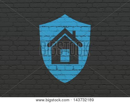 Business concept: Painted blue Shield icon on Black Brick wall background