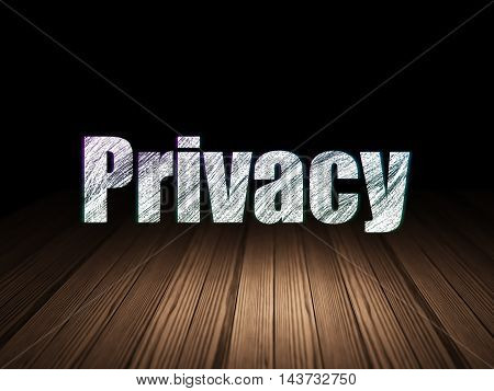Privacy concept: Glowing text Privacy in grunge dark room with Wooden Floor, black background