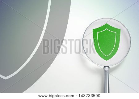 Protection concept: magnifying optical glass with Shield icon on digital background, empty copyspace for card, text, advertising, 3D rendering