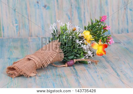 Bouquet of flowers  on old wood table