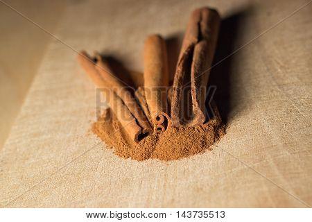 Lightened Cinnamon on wood background  - food photo